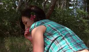 Outdoor sex session features a tremendous brunette legal age teenager on grass