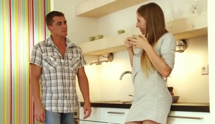 Tempting babe Morgan Moon gives footjob before steamy sex right on the kitchen table