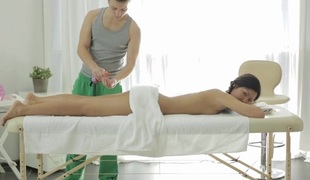 Young darling is obtaining a steamy sexy body massage