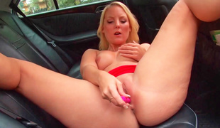 Freaky sweetheart is massaging her soaked pussy in a car