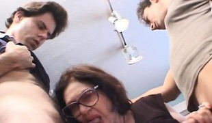 Lustful granny with large breasts has two juvenile dudes sharing her pussy
