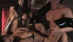 Pleasing brunette mistress introduces a lascivious pair to perverted sex