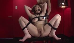 Asian babe is doing bondage