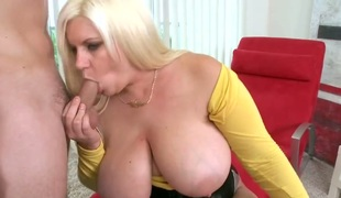 Blonde Tiffany Blake with phat arse shows her cock engulfing talents in blowjob action with hot guy
