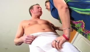 Flirtatious milf with big tits giving an arousing tit job