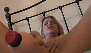 Angelic blonde with admirable ass getting drilled using huge dildo doggystyle