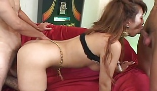 Lascivious oriental enjoys three-some