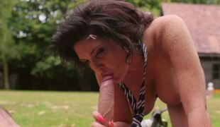 A brunette hair is out in the yard, naked, getting rammed by a stud
