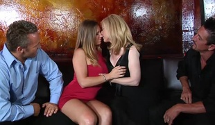 Captivating blonde with big tits in stocking getting team-fucked doggystyle in foursome