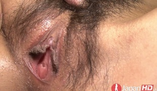 Yummy creampied Oriental pussy in closeup clip