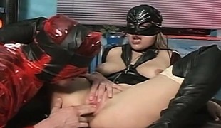 Leather loving nympho has a kinky fellow roughly drilling her taut ass