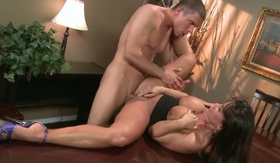 Lisa Ann with massive breasts satisfies her sexual needs and desires with Mick Blues rod in her mouth