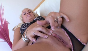 Blonde cougar with an awesome body playing with a giant plastic cock