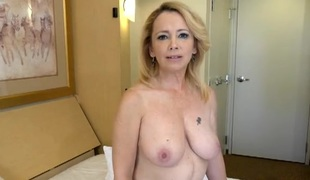 Naked mature honey interviews in a hotel room