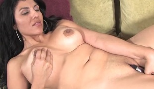 Dildo buried in the pussy of a hawt Latin milf