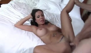 Busty Amy sits on a long dick