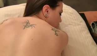 Small tits dark brown is getting her tattooed body loved on the bed