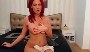 Sexy stripteasing redhead babe seduces on webcam with her sexy body