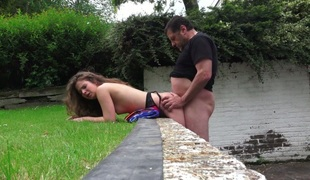 Sexy girl Bunny Babe fucks mature guy on a lawn outdoor