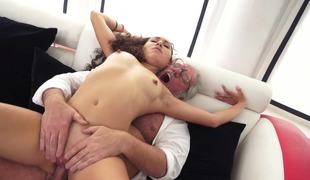 A unshaved lengthy haired minx is feeling a grandad inside her wet pussy