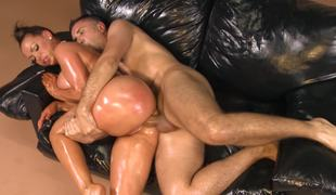 A perverted milf is getting her body oiled up and penetrated