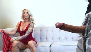 Blond milf that likes anal is handling a large and hard juicy cock