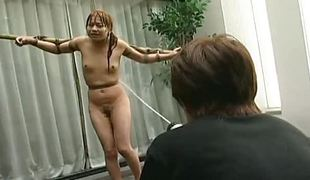 Tied up Asian babe soaked with a water pantyhose