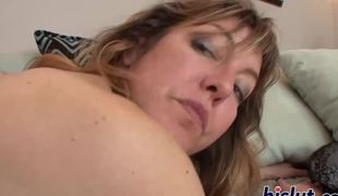 Mature slut fucks herself with a large toy