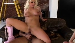 Concupiscent blond milf Nikki Hunter takes a throbbing prick in each hole