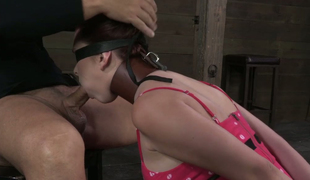 Dark red haired breasty bitch with large rack is blindfolded and face fucked