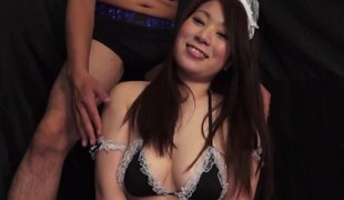 Pleasant Japanese maid in sexy fishnets sucks a hard dick