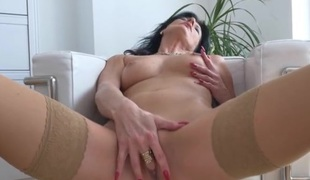 Classy masturbating milf with a hand down her panties