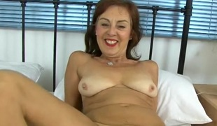 Taut mature gash is palatable as that babe masturbates