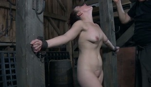 Bounded slave beauty is getting a lusty wet crack punishment