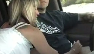 Lascivious golden-haired MILF wanking uncle's dick whilst he's driving