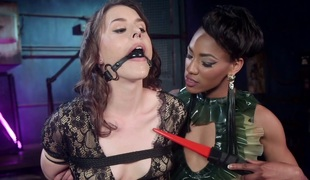 Electro  floozy Nikki Darling punishes one fastened playgirl in the dark room