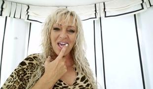 Provocative white granny fucks gracious black guy in sexual porn clip