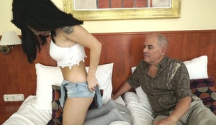 Brunette Oriental gal gets nailed deep in her vagina in a doggy position