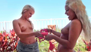 Two girls are fooling around by the pool with guys
