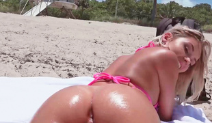 Bikini falls off a hawt golden-haired at the beach and she does anal