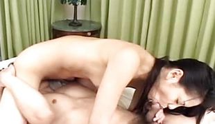 Asian brunette slavers over this stiff cock