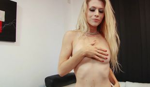 A blonde removes her clothes and then she sucks a large dildo