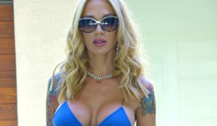 Tattooed blonde fondling fake tits when ravished hardcore