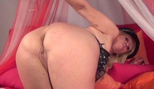 Older blonde slut Annika loves pounding her cunt with a sex toy