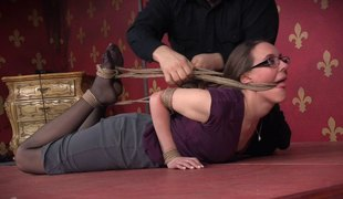 Nerdy submissive tied up harshly by her dom
