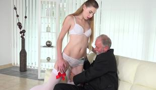 Old businessman fucks a gorgeous blonde escort on the couch