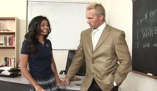 Lascivious teacher fucks a cute schoolgirl in the classroom