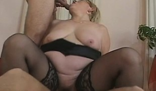 Concupiscent older plumper in darksome nylons engages in a wild trio