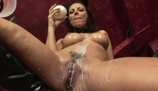 Awesome doxy in leather boots strokes and soaks her muff with milk before toy fucking