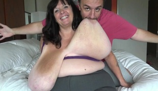 Fatty with giant breasts likes having him suck on them